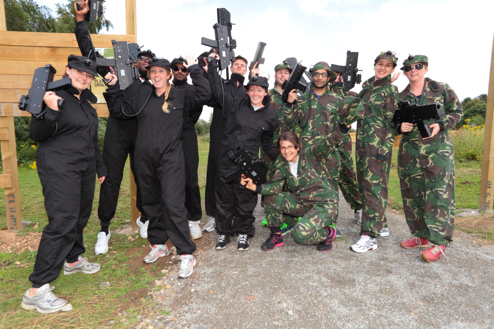 A group of people with laser tag weapons