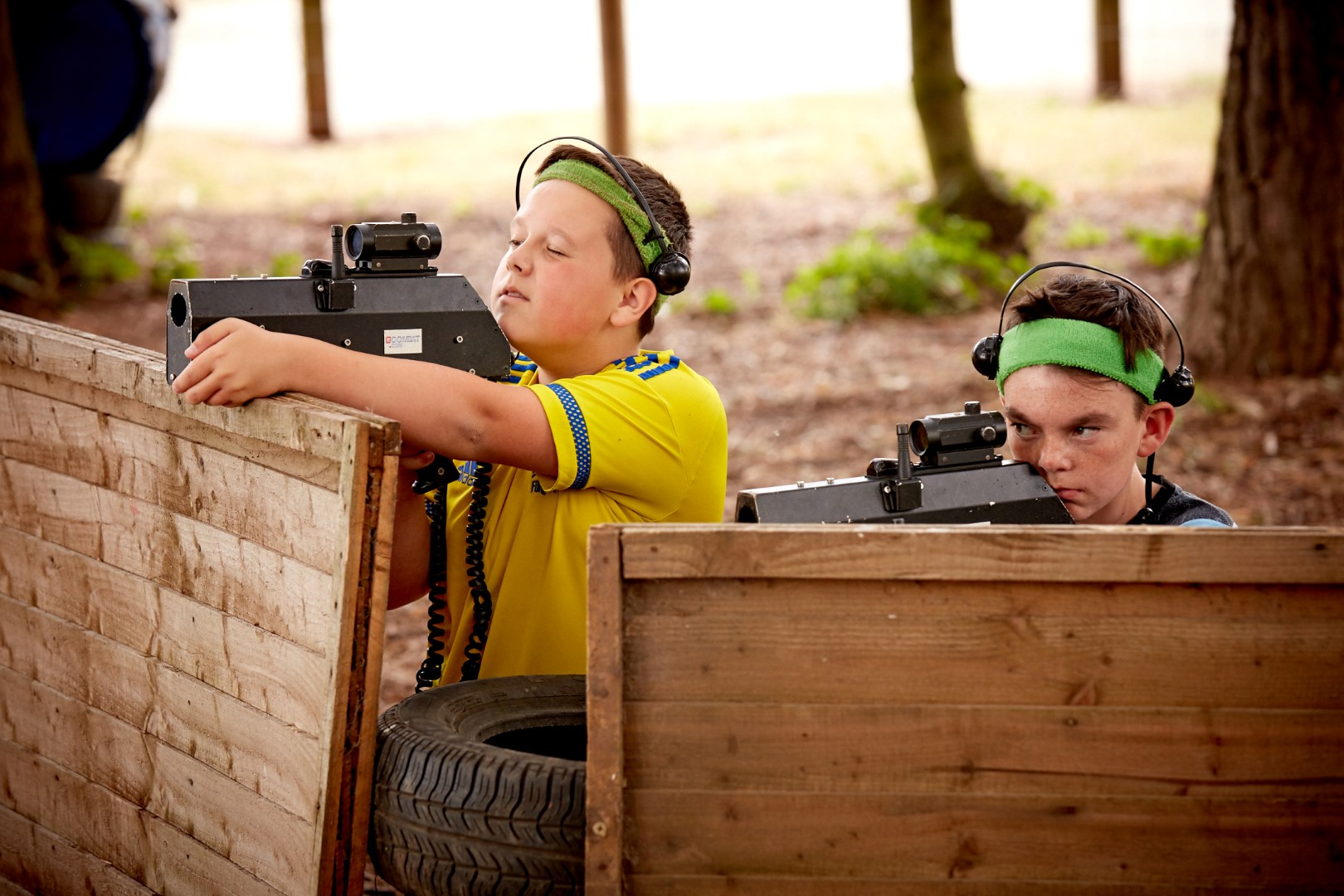 Two boys firing laser tag guns